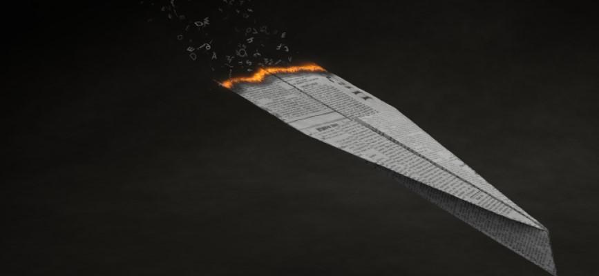 Newspaper plane on fire